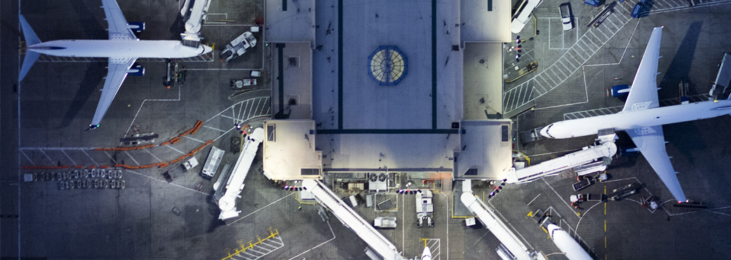 Image of planes docking in an airport from above