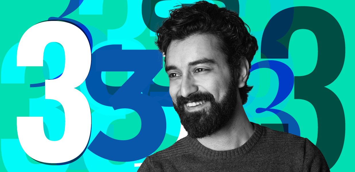 Man smiling infront of a number 3 graphical background