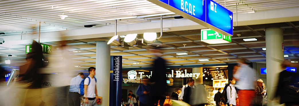 Image of passengers outside airport shops