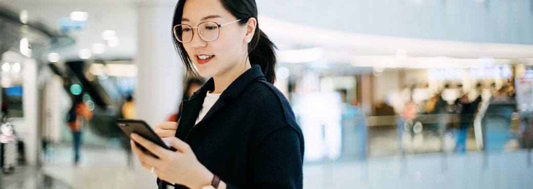 Young woman using phone for banking