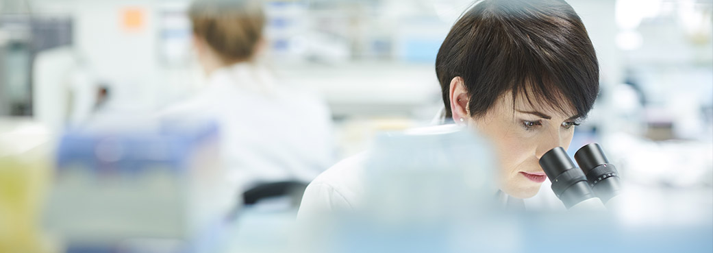 Image of a scientist inspecting samples in a lab