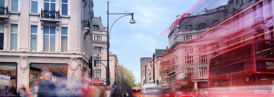 Image of london traffic through a busy shopping district