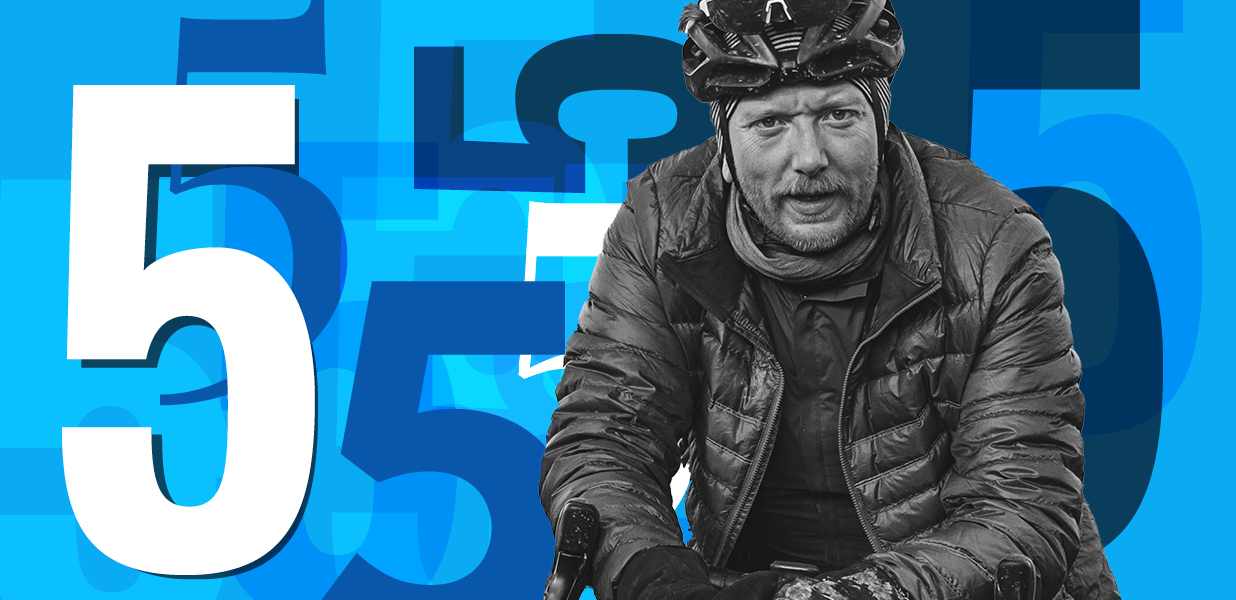 Man on bike infront of a number 5 graphic