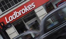 GVC raises profit outlook again, to shut fewer shops