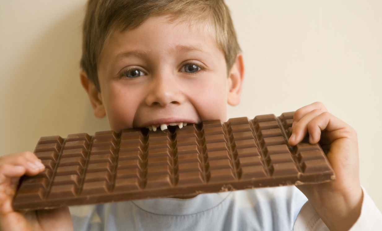 Junk food giants must stop marketing to children - or see their ads banned entirely, says health chief