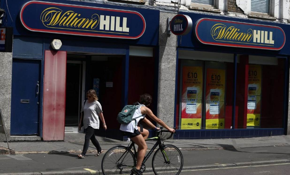 William Hill profit hit by regulatory cap, US expansion costs