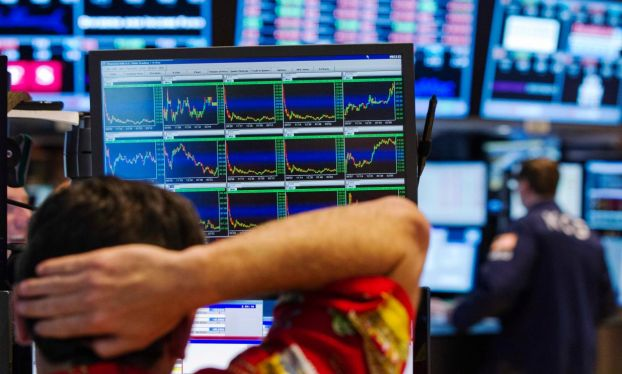 Stock markets surge after French election result