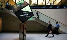 Defensive shares keep Britain's FTSE aloft