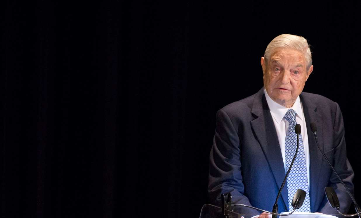 george soros sells stock and buys gold